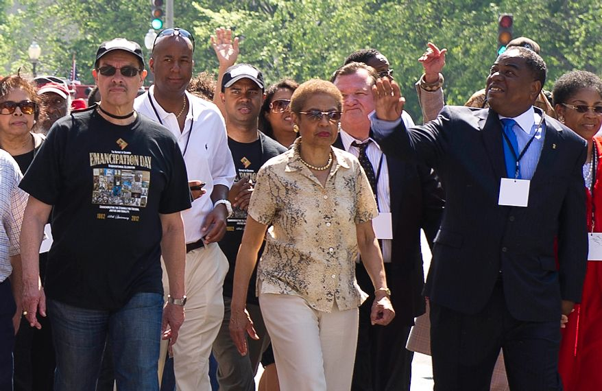 Rep. Eleanor Holmes Norton (D-DC, center) is joined by Washington, D.C. Mayor Vincent C. Gray (left) and Council Member At-Large Vincent Orange (right) as they march in the District of Columbia Emancipation Day 2012 parade in Washington, D.C., Monday, April 16, 2012., celebrating the150th anniversary of the District of Columbia Emancipation Act. 150 ears ago, on April 16, 1862, President Abraham Lincoln signed a bill ending slavery in the District of Columbia. Passage of this law came 8 1/2 months before President Lincoln signed his Emancipation Proclamation. (Rod Lamkey Jr/The Washington Times)