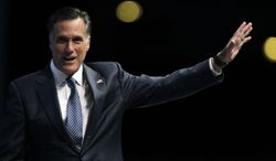 Republican presidential candidate and former Massachusetts Gov. Mitt Romney waves after speaking April 13, 2012, at the National Rifle Association convention in St. Louis. (Associated Press)