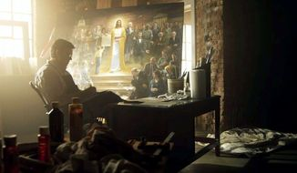 "Mr. McNaughton works in his Provo, Utah, studio on ""One Nation Under God,"" in which Christ presents the Constitution to a group of Founding Fathers and archetypal Americans."
