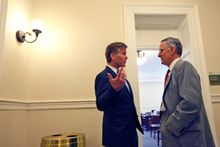 Virginia Gov. Bob McDonnell (left) chats with Senate Majority Leader Thomas K. Norment Jr., James City Republican, outside the Senate Republican Caucus room at the Capitol in Richmond on Tuesday. The governor addressed the caucus before the debate and vote on the budget. The Senate failed to pass the budget. (Associated Press)
