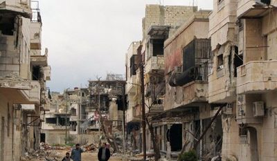 The Inshaat neighborhood in the opposition stronghold of Homs shows the results of regime shelling. More than 9,000 have died in the 13-month uprising. (Associated Press)