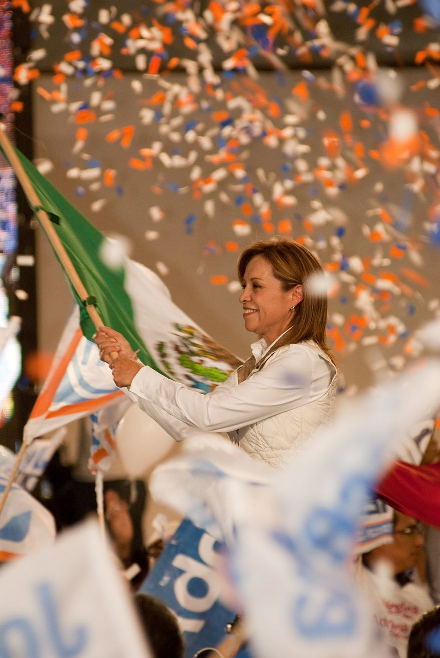 Josefina Vasquez Mota waves a Mexican flag at a rally last week in her campaign to win the presidency. (Keith Dannemiller/Special to The Washington Times)