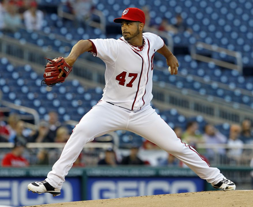 ** FILE ** Washington Nationals starting pitcher Gio Gonzalez delivers to the Houston Astros during the first inning in Washington on Tuesday, April 17, 2012. (AP Photo/Ann Heisenfelt)