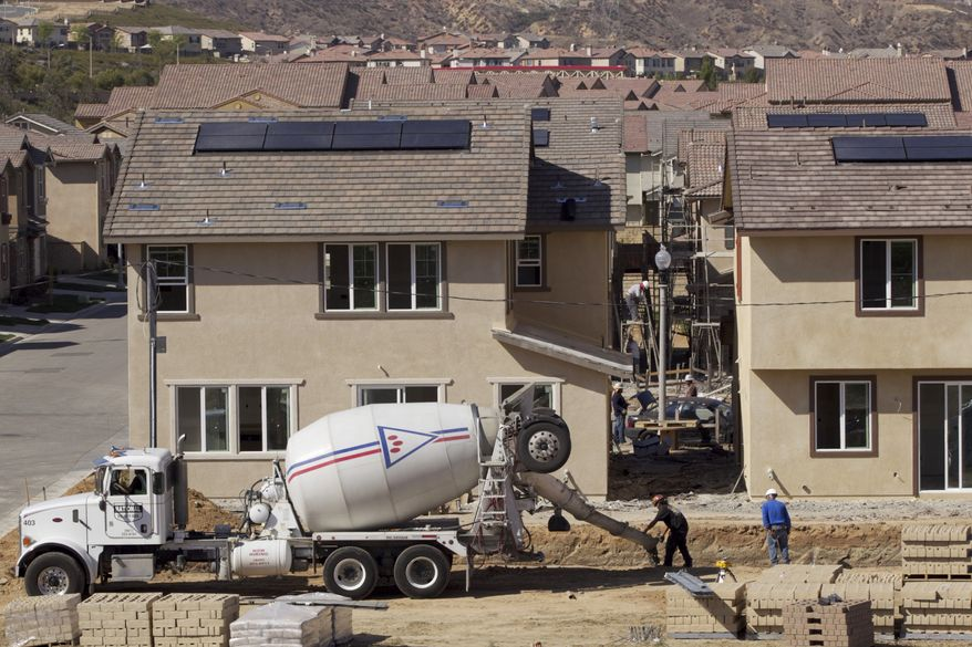The homebuilder Lennar constructs new single-family detached houses at the Aria at West Creek development in Santa Clarita, Calif., on Thursday, March 15, 2012. (AP Photo/Damian Dovarganes)