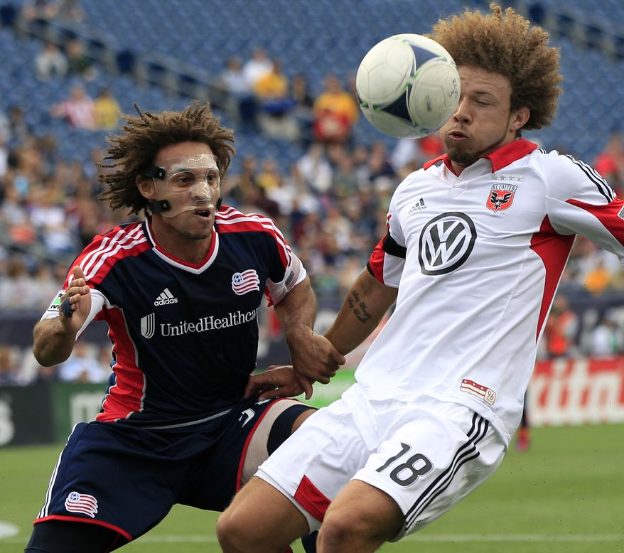 D.C. United's Nick DeLeon (18) controls the ball against New England Revolution's Kevin Alston during the first half of an MLS soccer match in Foxborough, Mass., on Saturday, April 14, 2012. (AP Photo/Elise Amendola)