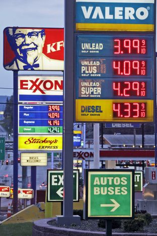 Gas prices are posted at gas stations in Breezewood, Pa., Monday, April 9, 2012. (AP Photo/Gene J. Puskar)