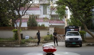 Police commandos stand guard on Tuesday, April 17, 2012, outside a house in Islamabad, Pakistan, where family members of the late al Qaeda leader Osama Bin Laden are believed to be held. (AP Photo/Anjum Naveed)
