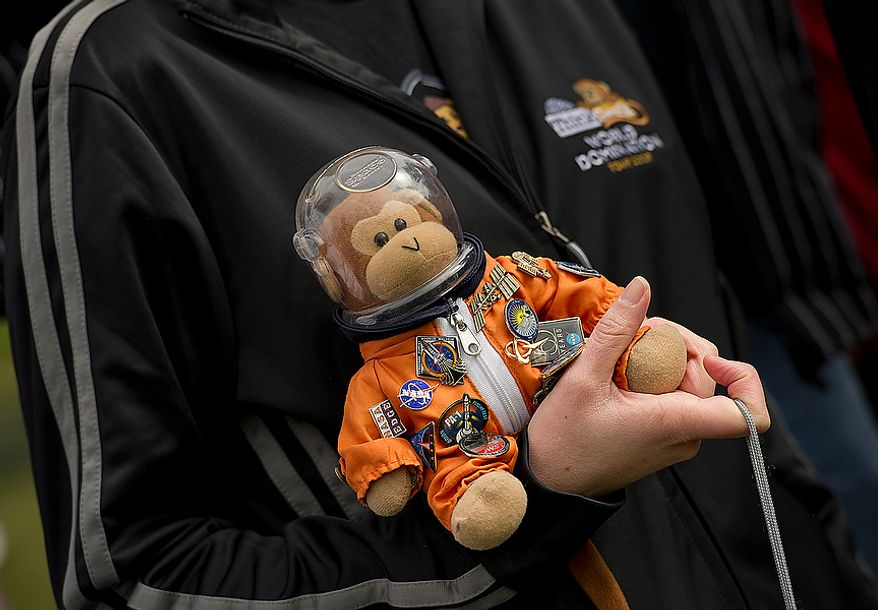 """""""Timmy"""" the monkey joined the Think Geek crew as they watched the space shuttle Discovery fly past the Smithsonian Air and Space Museum's Udvar-Hazy Center in Chantilly, Va., on Tuesday, April 17, 2012. Timmy has been to at least five shuttle launches. (Barbara L. Salisbury/The Washington Times)"""