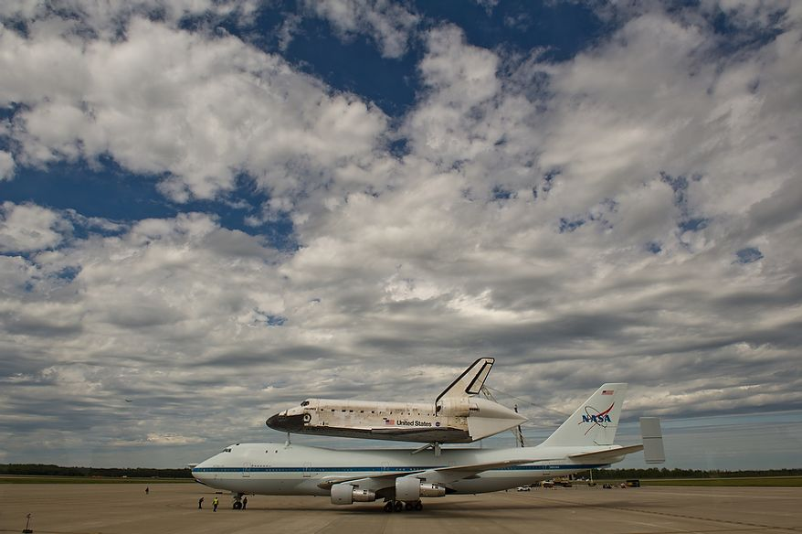 The space shuttle Discovery arrives by 747 carrier aircraft at Washington Dulles International Airport, Chantilly, Va., Tuesday, April 17, 2012. After completing 39 missions and spending 365 days in space, the historic spacecraft will make its final destination at the Steven F. Udvar-Hazy Center, a Smithsonian museum, located in Chantilly, Va. on Thursday, April 19th. (Andrew Harnik/The Washington Times)