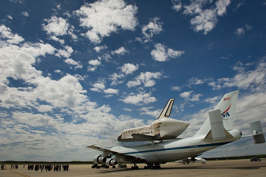 The space shuttle Discovery arrives by 747 carrier aircraft at Washington Dulles International Airport, Chantilly, Va., Tuesday, April 17, 2012. After completing 39 missions and spending 365 days in space, the historic spacecraft will make its final destination at the Steven F. Udvar-Hazy Center, a Smithsonian museum, located in Chantilly, Va., on Thursday, April 19. (Andrew Harnik/The Washington Times)