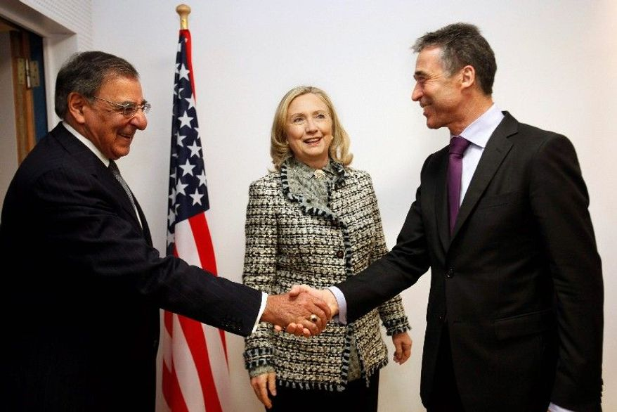 """""""There is no change whatsoever in the timeline"""" for troops to leave Afghanistan, NATO chief Anders Fogh Rasmussen (right) said Wednesday in Brussels, where he met with Defense Secretary Leon E. Panetta and Secretary of State Hillary Rodham Clinton. (Associated Press)"""