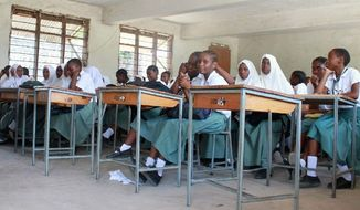 Classes for students at Gerezani Secondary School, and at other secondary schools in Tanzania, are taught only in English. Some students struggle with the language since it is spoken in relatively few homes, but English remains an official language, along with Kiswahili, one of 120 local languages. (Anna Patton/Special to The Washington Times)