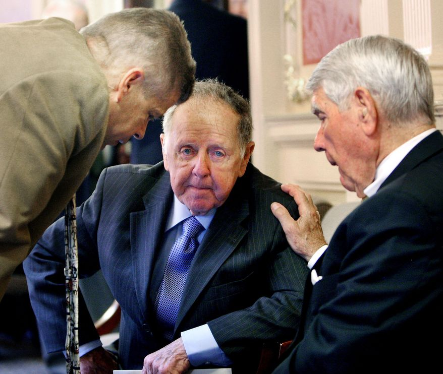 House Majority Leader M. Kirkland Cox (left), a Republican, Sen. Charles J. Colgan, a Democrat, and independent Delegate Lacey E. Putney (right) confer Wednesday before Mr. Colgan changed his vote to approve the budget bill. (Associated Press)