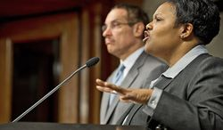 D.C. Schools Chancellor Kaya Henderson and Mayor Vincent C. Gray answer questions Wednesday about the five goals in their five-year plan to aggressively rebuild the District's public school system. (Barbara L. Salisbury/The Washington Times)