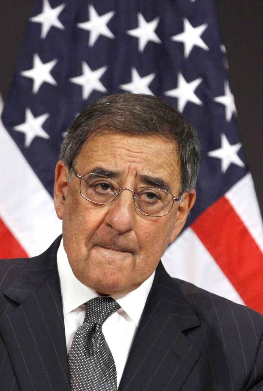 Defense Secretary Leon Panetta listens April 18, 2012, during a joint news conference with Secretary of State Hillary Rodham Clinton at NATO Headquarters in Brussels, Belgium, to a question about photographs published in the Los Angeles Times of soldiers posing with dead insurgents. (Associated Press)