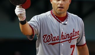 **FILE** In this Sept. 28, 2011, photo, Washington Nationals catcher Ivan Rodriguez acknowledges cheers form the crowd before batting during a baseball game against the Florida Marlins in Miami. (AP Photo/Lynne Sladky)