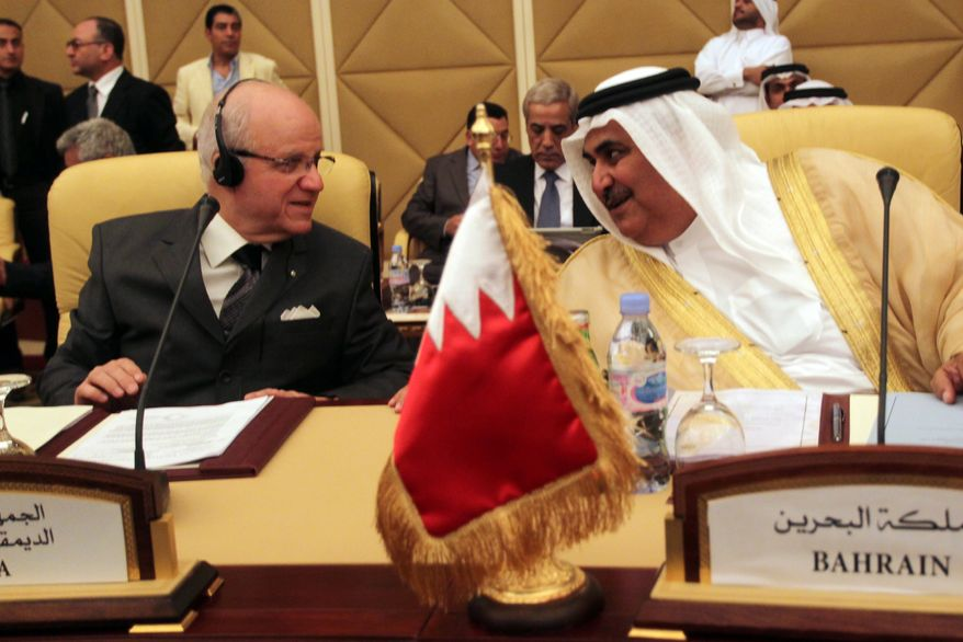 Bahrain Foreign Minister Sheikh Khaled bin Ahmad al-Khalifa (right) speaks April 17, 2012, with Algerian Minister of Foreign Affairs Mourad Medelci during the meeting of the Committee of Ministers of the Arab League to discuss the situation in Syria taking place in Doha. (Associated Press)