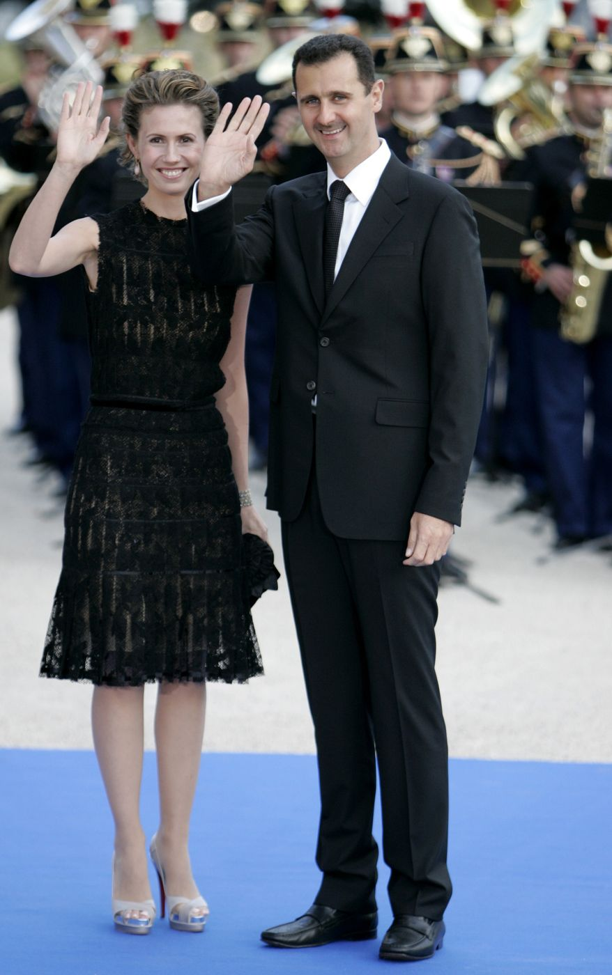 **FILE** Syrian President Bashar Assad and his wife Asma arrive July 13, 2008, for a formal dinner after a Mediterranean Summit meeting at the Petit Palais in Paris. (Associated Press)