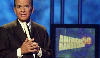 **FILE** Dick Clark, host of the American Bandstand television show, introduces entertainer Michael Jackson on stage April 20, 2002, during taping of the show's 50th anniversary special in Pasadena, Calif. (Associated Press)