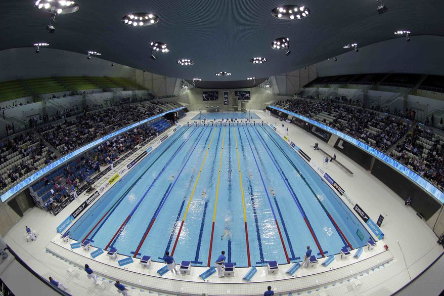 ** FILE ** This March 9, 2012, file photo shows swimmers competing in the men's 1500 meter freestyle during the British Swimming Championship selection trials and Olympic test event at the London 2012 Olympic Aquatics Centre at the Olympic Park in London. (AP Photo/Sang Tan, File)