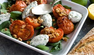 ** FILE ** Crunchy walnuts are featured in this composed salad made from roasted tomatoes and creamy, herbed ricotta cheese. Carefully toast raw nuts and seeds to get the most out of their deep, rich flavor. (Associated Press)