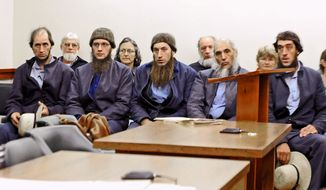 From left, Johnny Mullet, Lester Mullet, Daniel Mullet, Levi Miller and Eli Miller wait to make their pleas in Holmes County Municipal Court in Millersburg, Ohio, in October in the case involving beard- and hair-cutting attacks. (Associated Press)