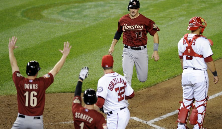Houston Astros' Jason Castro (15) comes in to score on a single by Bud Norris during the sixth inning versus Washington Nationals relief pitcher Tom Gorzelanny (32) on Thursday, April 19, 2012, in Washington. The Astros won 11-4. (AP Photo/Nick Wass)