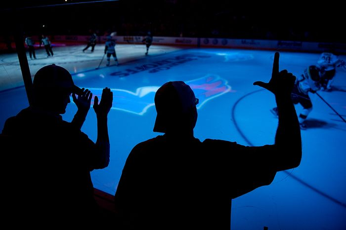 "Jason Bach, right, of Crownsville, Md., right, makes an ""L"" for ""Loser"" as the Boston Bruins skate out to the ice before the puck drop as the Washington Capitals take on the Boston Bruins in game four of National Hockey League first round playoff hockey at the Verizon Center, Washington, D.C., Th"