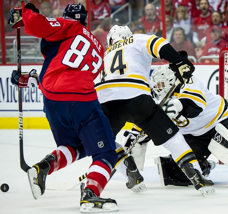 Boston Bruins goalie Tim Thomas (30), right, tries to get to a loose puck in the first period as the Washington Capitals take on the Boston Bruins in game four of National Hockey League first round playoff hockey at the Verizon Center, Washington, D.C., Thursday, April 19, 2012. (Andrew Harnik/The Washington Times)