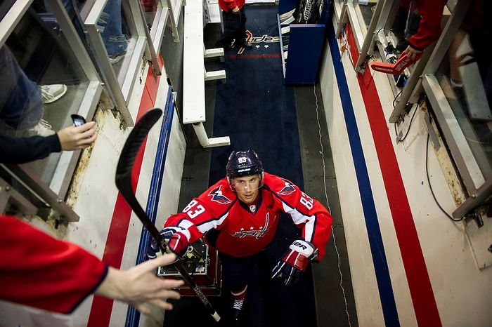 Washington Capitals center Jay Beagle (83) walks back to the locker room after warming up before the Caps took on the Boston Bruins in game four of the National Hockey League's first-round playoffs at the Veri