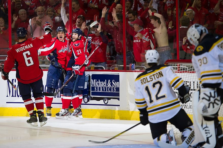 Washington Capitals defenseman Dennis Wideman (6), left wing Alex Ovechkin (8) (second from left) and center Brooks Laich (21) celebrate an early goal by Caps center Marcus Johansson (not visible) to put the Washington ahead 1-0 as they took on the Boston Bruins in game four of the National Hockey League's first-round playoffs at the Verizon Center in Washington on Thursday, April 19, 2012. (Andrew Harnik/The Washington Times)