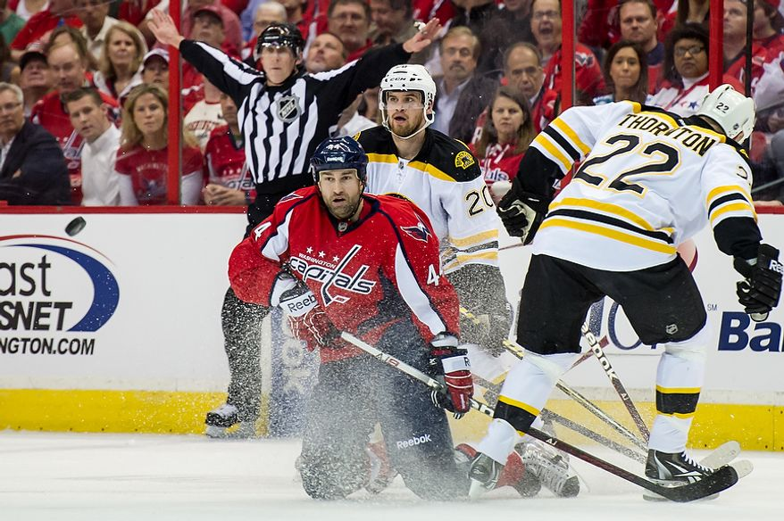 ** FILE ** Washington Capitals defenseman Roman Hamrlik (44) (left), Boston Bruins left wing Daniel Paille (20) (second from right) and Bruins right wing Shawn Thornton (22) battle for the puck in the first period as the Capitals took on the Bruins in game four of the National Hockey League's first-round playoffs at the Verizon Center in Washington on Thursday, April 19, 2012. (Andrew Harnik/The Washington Times)
