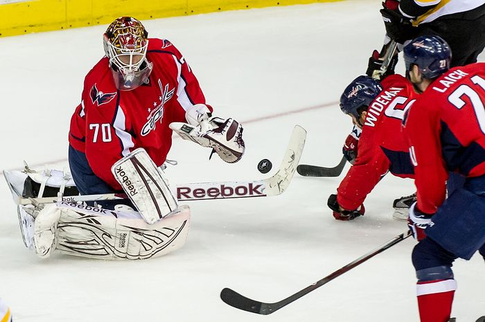 Washington Capitals goalie Braden Holtby (70) makes a play on the puck in the second period as the Caps took on the Boston Bruins in game four of the National Hockey League's first-round playoffs at the Verizon Center in Washington on Thursday, April 19, 2012. (Andrew Harnik/The Washington Times)