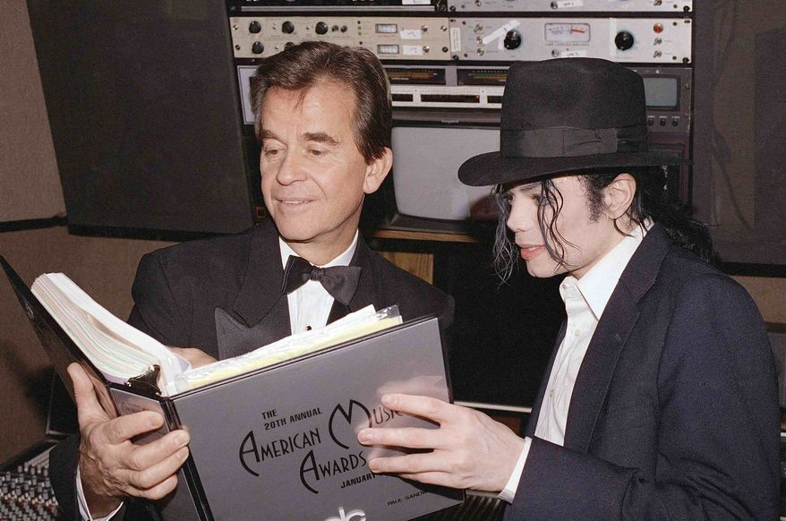 ** FILE ** In this Jan. 24, 1993, file photo, singer Michael Jackson and American Music Awards executive producer Dick Clark go over the script during rehearsals for the American Music Awards at the Shrine Auditorium in Los Angeles. (AP Photo/file)