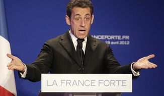 France's President and candidate for re-election in 2012, Nicolas Sarkozy, gestures as he delivers a speech during a campaign meeting in Saint Maurice, outside Paris, Thursday, April 19, 2012. (AP Photo/Michel Euler)