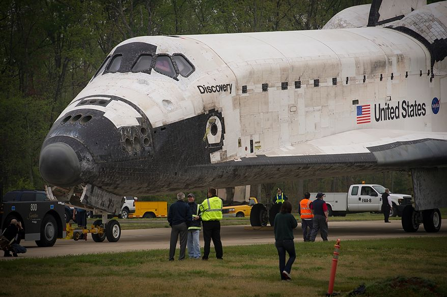 The NASA space shuttle Discovery sits parked on a road before the celebrations at the National Air and Space Museum's Steven F. Udvar-Hazy Center in Chantilly, Va., on Thursday, April 19, 2012. (Rod Lamkey Jr./The Washington Times)