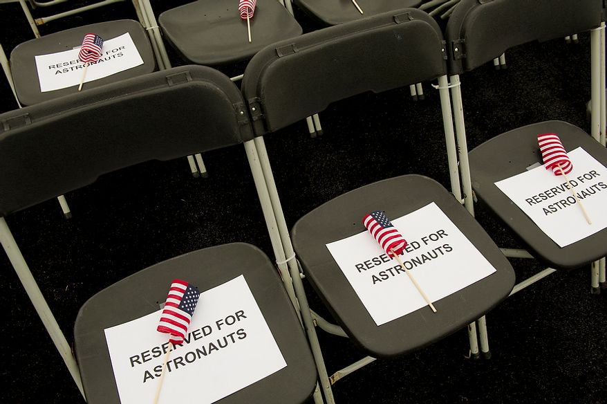 Seats are reserved with American flags for astronauts before the ceremonial arrival of the NASA space shuttle Discovery at the National Air and Space Museum's Steven F. Udvar-Hazy Center in Chantilly, Va., on Thursday, April 19, 2012. (Rod Lamkey Jr./The Washington Times)