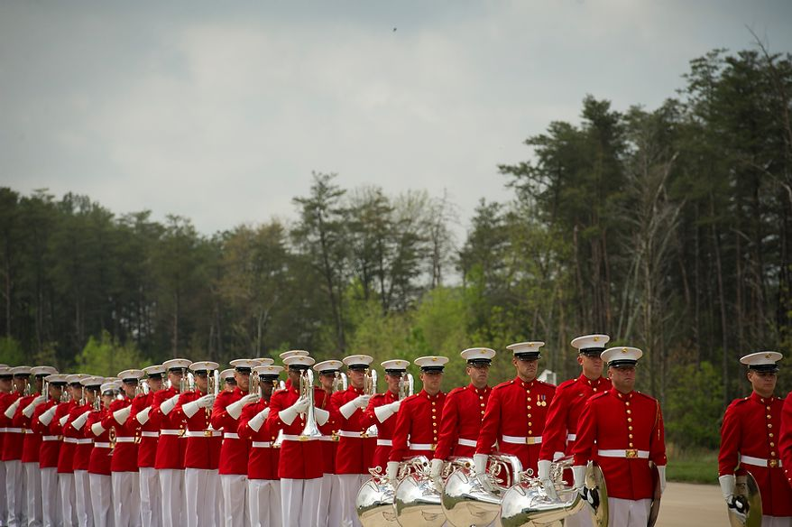 The U.S. Marine Drum and Bugle Corps line up and prepare to perform during the ceremonial arrival of the NASA space shuttle Discovery at the National Air and Space Museum's Steven F. Udvar-Hazy Center in Chantilly, Va., on Thursday, April 19, 2012. (Rod Lamkey Jr./The Washington Times)