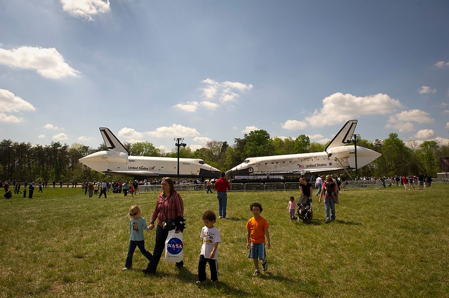 The NASA space shuttles Enterprise (left) and Discovery (right) are nearly nose to nose during the ceremonial arrival of Discovery at the National Air and Space Museum's Steven F. Udvar-Hazy Center in Chantilly, Va., on Thursday, April 19, 2012. (Rod Lamkey Jr./The Washington Times)