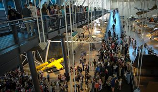 People pack the catwalks at the National Air and Space Museum's Steven F. Udvar-Hazy Center in Chantilly, Va., (Rod Lamkey Jr./The Washington Times)