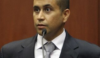 George Zimmerman appears before Circuit Judge Kenneth R. Lester Jr. Friday, April 20, 2012, during a bond hearing in Sanford, Fla. Lester says Zimmerman can be released on $150,000 bail as he awaits trial for the shooting death of Trayvon Martin. (AP Photo/Orlando Sentinel, Gary W. Green, Pool)
