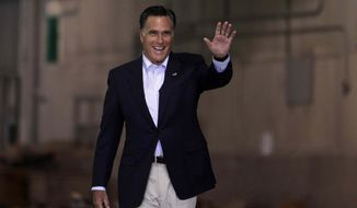 Republican presidential candidate, former Massachusetts Gov. Mitt Romney waves as he arrives for a campaign rally at the closed National Gypsum drywall factory in Lorain, Ohio, Thursday, April 19, 2012. (AP Photo/Jae C. Hong)