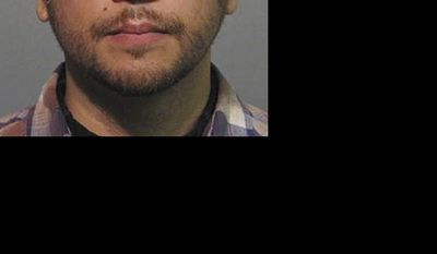 ** FILE ** This Wednesday, April 11, 2012, file booking photo provided by the Sanford Police Department shows George Zimmerman. (AP Photo/Sanford Police Department, File)