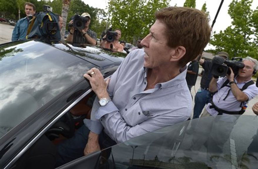 Mark O'Mara, attorney for George Zimmerman, gets into his car after speaking with his client at the Seminole County Jail in Sanford, Fla. on Saturday, April 21, 2012. Zimmerman was a neighborhood watch volunteer who shot unarmed teenager, Trayvon Martin. O'Mara said it would take a few days before Zimmerman is released. His family needs time to secure collateral for the bail, Zimmerman needs to be fitted with an electronic monitoring device and O'Mara said he must find a secure location for him. (AP Photo/Phelan M. Ebenhack)