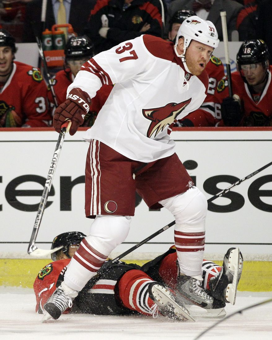 Chicago Blackhawks' Marian Hossa falls down after a late hit from Phoenix Coyotes' Raffi Torres during the first period of Game 3 of the first-round playoff series in Chicago on Tuesday, April 17, 2012. (AP Photo/Nam Y. Huh)
