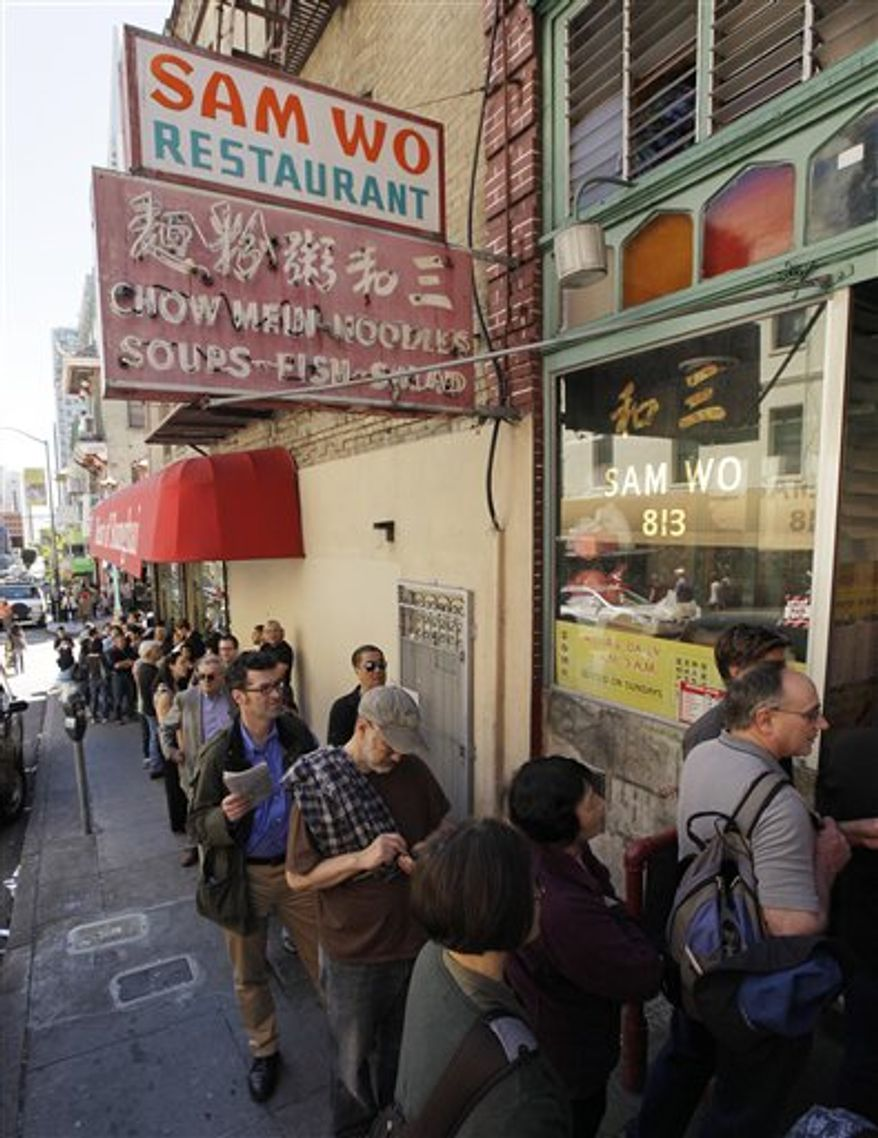 """Customers line up for one final meal at the Sam Wo restaurant in Chinatown in San Francisco, Friday, April 20, 2012. The 100-year-old Chinese restaurant known for having """"the world's rudest waiter"""" is shutting its doors and serving its last customers Friday. (AP Photo/Eric Risberg)"""