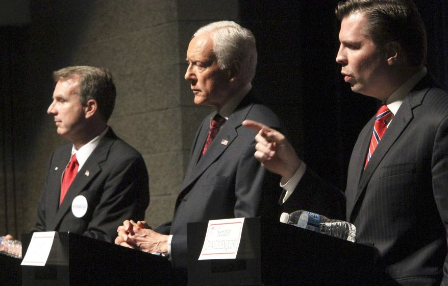 ** FILE **  In this April 4, 2012, file photo, Sen. Orrin Hatch, center, faces off with Republican candidates for U.S. Senate Chris Herrod, left, and and Dan Liljenquist, during a debate sponsored by the Utah League of Women Voters in Salt Lake City. (AP Photo/The Salt Lake Tribune, Rick Egan, File)