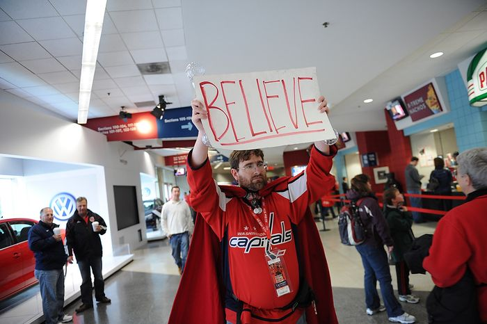 "Trevor White, of Silver Spring, Md., carries his ""Believe"" sign among the crowd as the Washington Capitals host the Boston Bruins in the Eastern Conference Quarterfinals Game 6 at the Verizon Center in Washington, D.C., Sunday, April 22, 2012. (Rod Lamkey Jr/The Washington Times)"