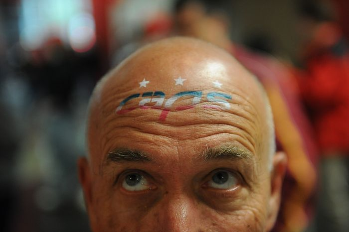 Bill Jones, of Potomac, Md., wears a Capitals logo on his forehead for a portrait as he arrives for the Eastern Conference Quarterfinals Game 6 between the Washington Capitals and the Boston Bruins at the Verizon Center in Washington, D.C., Sunday, April 22, 2012. (Rod Lamkey Jr/The Washington Times)