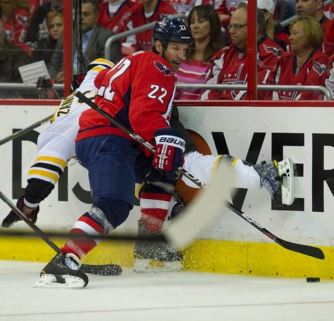 Mike Knuble (22) collides with Greg Zanon (6) of the Washington Capitals of the Boston Bruins in the first period of the Eastern Conference Quarterfinals Game 6 at the Verizon Center in Washington, D.C., Sunday, April 22, 2012. (Rod Lamkey Jr/The Washington Times)